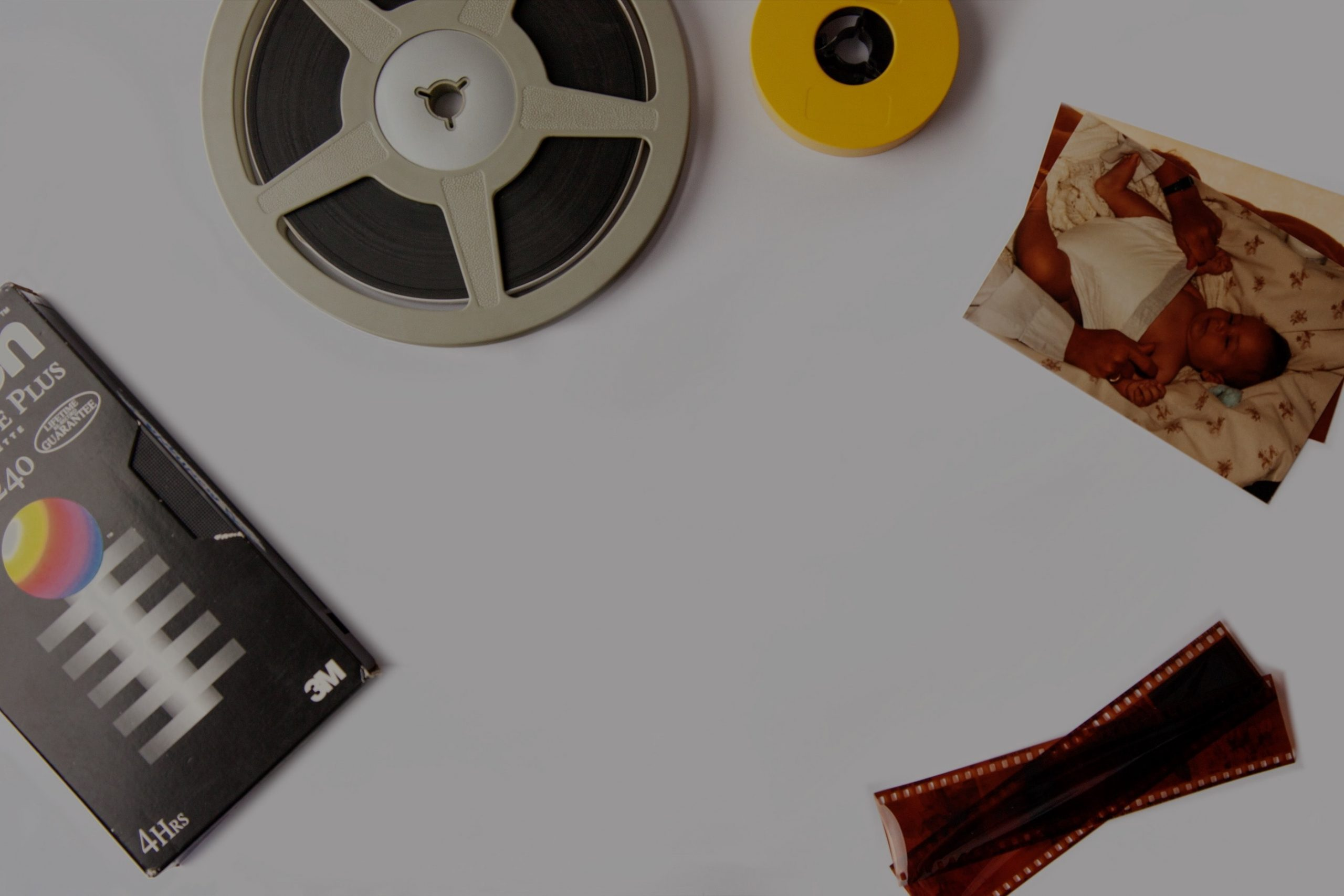 VHS tape, cinefilm and an old family photo